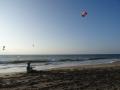 David's teaching Dorit how to control a kite